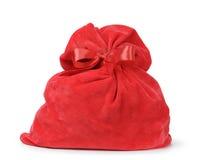 Röd santas påse från sammettyg Arkivfoto
