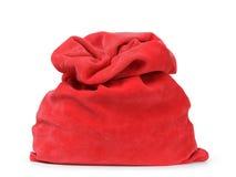 Röd santas påse från sammettyg Arkivbild