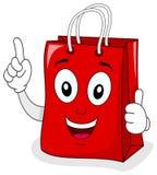 Röd shoppingpåse med tummar upp Arkivbilder