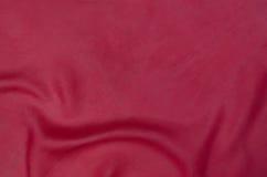 Röd siden- texturbackgound Arkivfoton