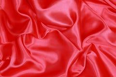 Röd siden- torkduk av krabb abstrakt bakgrund Arkivfoto
