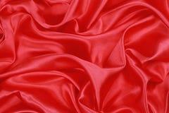 Röd siden- torkduk av krabb abstrakt bakgrund Arkivfoton