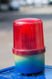 Röd sirenlampa på den blåa asken Royaltyfri Foto