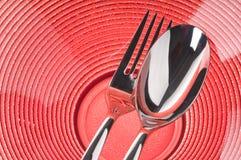 röd sked för gaffelplatta Arkivfoton