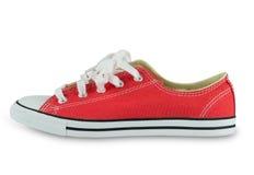 Röd sko för mode som isoleras på vit bakgrund Arkivfoton
