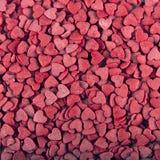 Röd sockerhjärtabakgrund Fotografering för Bildbyråer