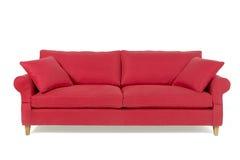 Röd soffa fotografering för bildbyråer