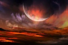 Röd solnedgång och måne Royaltyfri Foto