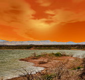Röd solnedgång sjö Arkivbilder