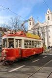 Röd spårvagn och St Paul kyrka. Lissabon. Portugal Royaltyfri Foto