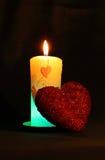 Röd sparkling hjärta med stearinljuset Royaltyfri Foto