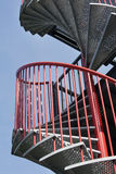 Röd spiraltrappuppgång Fotografering för Bildbyråer