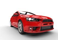 Röd sportbil på vit bakgrund - billyktaskott Arkivbilder