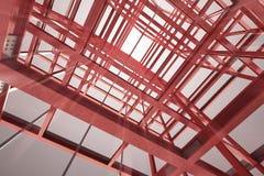 Röd stålram som bygger den inomhus suddiga siktstolkningen Arkivbild