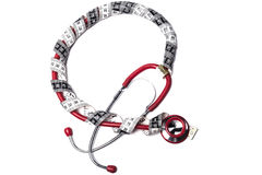Röd stetoskop och band arkivfoton