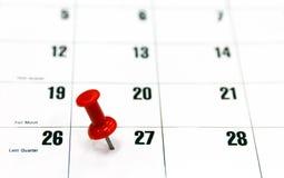 Röd stiftkalender royaltyfri fotografi