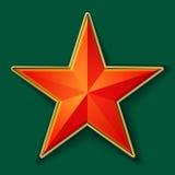 Röd stjärna med den guld- ramen Arkivbild