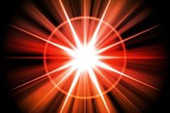 röd stjärnasunburst för abstrakt brand Arkivfoto