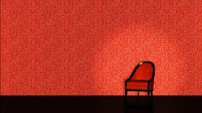 Röd stol på röd backround Arkivbild