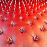 Röd stoppning för lädergrov spikdesign Arkivbilder