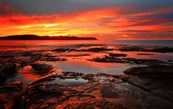 Röd strand Australien för soluppgångfiltpärla Arkivbilder