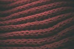 Röd tappning stack tygtextur och bakgrund för formgivare Tappning stucken bakgrund Övre sikt för slut av röd abstrakt textur Royaltyfria Foton