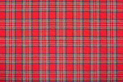Röd tartan, skotsk tygtextur, bakgrund Arkivfoto
