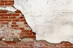 Tegelsten- och stuckaturvägg Royaltyfria Foton
