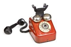 Röd telefon för tappning som isoleras på vit bakgrund Royaltyfria Foton