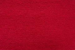 Röd textilbakgrund för fantastisk kontrast på makro royaltyfri bild