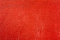 Röd textiltextur med att blekna och skrapor abstrakt bakgrund Royaltyfri Foto