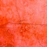 Röd textur för cementsprickavägg Royaltyfria Bilder