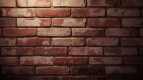Röd texturerad tegelstenvägg med belysning arkivfoto