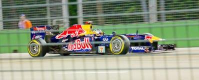 Röd tjurchaufför Sebastian Vettel Singapore F1 Arkivbild