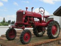 röd traktortappning Arkivbild