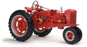 röd traktorwhite för bakgrund Royaltyfri Foto