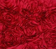 Röd tygbakgrund för rosett Arkivbild