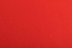 Röd tygbakgrundstextur Arkivbild