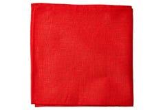 Röd tygservett på vit Arkivfoton