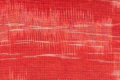 Röd tygtextur Fotografering för Bildbyråer