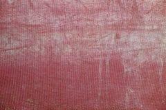 Röd tygtextur en fläckbakgrund Fotografering för Bildbyråer