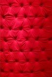 Röd tygupholstery Arkivfoton