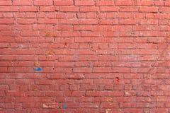 Röd vägg av målad tegelsten Royaltyfri Foto