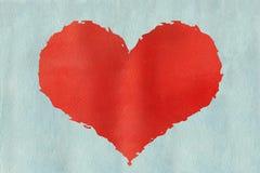 Röd vattenfärggrungehjärta på vattenfärgljus - blå bakgrund Arkivbild