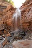 röd vattenfall Royaltyfri Bild
