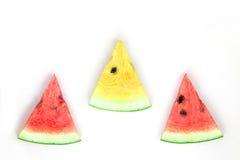 röd vattenmelon och skivat gult Arkivbilder