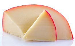 Röd vaxad holländsk ost fotografering för bildbyråer