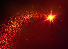Röd vektorstjärna med dammsvansen på mörk bakgrund Royaltyfri Bild