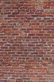 röd vertikal vägg för tegelsten Arkivbild