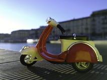 Röd vespamodell som parkeras på sidan av den Darsena pir i Milan Italy Arkivbild